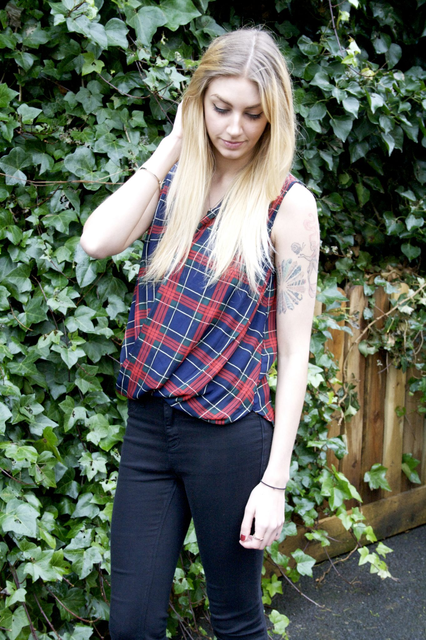 Manchester based fashion and lifestyle blogger. Tiger mist tartan vest, river island jeans, toni and guy blonde, tattoos.