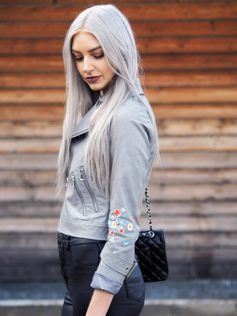 Manchester based fashion and lifestyle blogger Laura Kate Lucas   Dezzal Outfit Post featuring pink silk cami and grey embroidered biker jacket